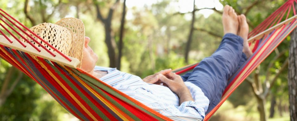 Senior Man Relaxing In Hammock
